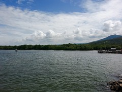 Seascape (Grathiael) Tags: blue trees light sea summer vacation sky sun sunlight white house mountain seascape tree green beach nature water leaves clouds rural boats outside boat leaf woods flickr day waves natural bright air cottage sunny serene