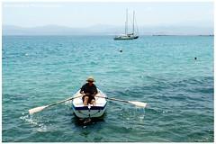 Boatman (Kevrekidis) Tags: street photography boat streetphotography greece ferryman boatman fhrmann eretria evia  passeur  strasenfotografie fotografacallejera   samsungwb380f