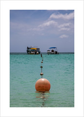 Buoys and Boats (andyrousephotography) Tags: blue sea sun holiday beach boats hotel coast kayak sailing turquoise venezuela aruba havaianas watersports wellies buoys palmbeach riupalace dutchcaribbean