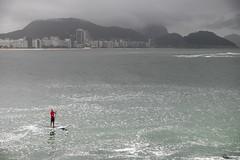 Paddling (Picardo2009) Tags: travel brazil storm rain riodejaneiro lluvia surf cloudy surfer paddle surfing tormenta traveling raining fortedecopacabana watersport picoftheday remar surfeando remando deportesacuaticos