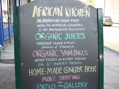 AFRICAN KITCHEN (RubyGoes) Tags: uk england black london car ginger hand pavement board papaya yam mango juices organic written sweetpotato dairyfree drummondst patiogallery