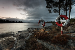 Safety duo (- David Olsson -) Tags: trees red 2 two white lake nature water night clouds dark landscape evening lowlight nikon couple cloudy sweden outdoor heather duo pair cliffs safety rings filter april late bluehour fx dim grad buoys hitech vnern firs d800 hammar trygghansa vrmland 1635 1635mm lakescape liferings gnd skoghall 2013 buoyant lifebuoys flickroid davidolsson 1635vr vstraskagene hammarkommun 12soft