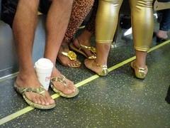 Golden slippers (yooperann) Tags: light summer people chicago green train gold sandals authority rail line passengers transit commuters chicagoist