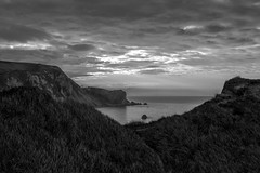 Man O War Bay (Mike Nethercott) Tags: door sea sky bw sun white man black grass clouds sunrise mono bay coast war o dorset rise jurassic durdle manowarbay