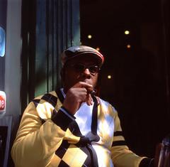 (Josh Sinn) Tags: man color 120 6x6 film hat sunglasses festival mediumformat sweater md fuji maryland slide cigar baltimore smoking barbershop provia e6 100f yashicamat124g sowebo joshsinn joshuasinn