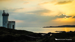 Lighthouse sunset (Bertie Allison) Tags: light sunset sea lighthouse water silhouette canon scotland fife 28mm forth elie firth helios 60d