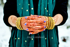 Saturation against the Whiteout (B.Bubble) Tags: winter woman snow girl scarf gold model vermont teal decoration nails henna bodyart mehndi bangles adornment