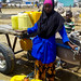 Ebyan Iftin rests after filling her jerry cans with water at a borehole in Dhobley