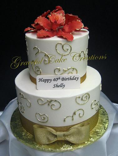 Elegant Gold And Ivory Birthday Cake With Burnt Orange Orchids