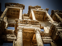 The Celsus Library - Ephesus (Anthony Plancherel) Tags: old travel building history tourism monument architecture turkey outside ancient outdoor decorative turkiye columns perspective ruin arches bluesky historic pointofview marble ornamental civilisation materials faade imposing motifs capitals efes antiquity magnificient celsuslibrary travelphotography lycian publicplace libraryofcelsus preroman epheseus buildingstructure carian samsung12nx ancirntbuilding