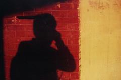 Red, Yellow, Black (Sheikh Shahriar Ahmed) Tags: shadow film analog 50mm f14 olympus om10 fujifilm zuiko fujicolorc200 epsonv330 sheikhshahriarahmed
