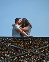 Kiss and hug by the love locks (Monceau) Tags: paris neck cadenas hug kiss lovelock pontdesarts flickr10photowalk flickrbingo3b9