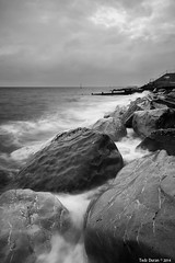 R O C K S (Tedz Duran) Tags: road trip travel sea urban bw white black west beach sussex landscapes rocks waves waterfront seascapes boulders 24mm seafront selsey duran tse tedz 5d3