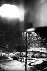 Midnight Treat (krwitschen) Tags: street snow storm cars lamp minnesota night path parking central lot covered