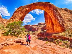 Brian and Gina at the Rainbow Bridge (Garen M.) Tags: arizona landscape utah day5 lakepowell rainbowbridge horseshoebend olympusomdem1 zuikopro714mmf28 zuikopro1440mmf28