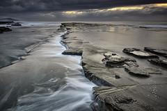 Uneven (Crouchy69) Tags: ocean sea sky seascape motion water clouds sunrise landscape flow dawn coast rocks waves australia nsw terrigal skillion