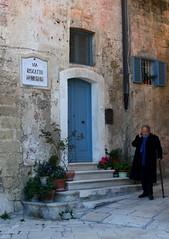Il riscatto  senza tempo (Sara Stampa) Tags: street italy man photography walk basilicata uomo matera sassi madeinitaly italiancountryside camminare rivincita riscatto borghiditalia cittdellacultura