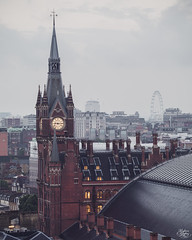 St Pancras (Umbreen Hafeez) Tags: city uk light england sky cloud building london tower clock water station st skyline architecture skyscraper buildings hotel europe cityscape estate cross outdoor structure kind infrastructure gb pancras