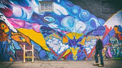 Walking By (IQRemix) Tags: urban canada building art wall graffiti artwork alley mural colorful downtown colours edmonton candid pedestrian alberta innercity brickbuilding urbanlife yeg yegdt