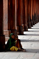 Untitled (Pharheen) Tags: street old shadow portrait people india history monument yellow architecture poor medieval solo misery pillars mughal uttarpradesh indianwomen sariwomen