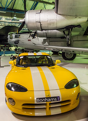 A 1995 Chrysler Viper Venom Roadster under  the wing of a Consolidated B24L-20-FO Liberator bomber at the RAF Museum, Hendon (Anguskirk) Tags: uk england london automobile wwii airplanes historic american 1995 sportscar militaria rafmuseumhendon royalairforce militaty chryslervipervenomroadster consolidatedb24l20foliberatorbomber