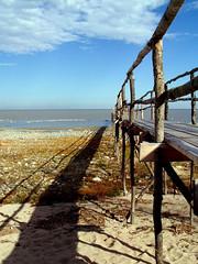 shadow lake (anniedaisybaby) Tags: lake beach clouds pier sand manitoba shore gimli interlake bluebluesky lakewinnipeg poplarpier
