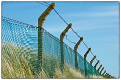 Happy Fence Friday (Keith Burton) Tags: grass fence bluesky barbedwire fencepost wirefence hff fencefriday