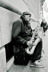 Saxophone Man (Point.of.View) Tags: park plaza new york city nyc bw white house man black streets film radio ads 50mm nikon kodak central professional 1950s nikkor f18 rockefeller rickshaw essex saxophone 3570mm c41 n6006 f3345