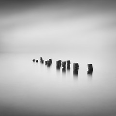 Guardians of the Sea (Alex_Smirnov) Tags: longexposure sea blackandwhite bw seascape monochrome square pier post minimal pole minimalism remains remnants waterscape