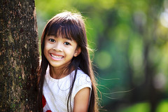 Cute little girl smiling in a park close up (Patrick Foto ;)) Tags: life park summer portrait people white tree cute green nature girl beautiful beauty face grass childhood smiling closeup female hair asian fun thailand happy person one kid model eyes toddler pretty child looking little outdoor expression bangkok background small joy daughter young lifestyle happiness blond thai innocence copyspace lovely cheerful joyful