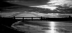 Runcorn Bridge (N_Davies. http://www.calvendo.co.uk/galerie/autor/) Tags: bridge sunset sky blackandwhite sunlight night contrast river landscape evening creative estuary rays tidal runcorn rivermersey runcornbridge