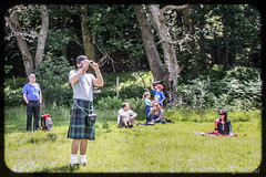 Shooting the photographer with the low slung sporran (FotoFling Scotland) Tags: camera scotland kilt photographer argyll event lochlomond highlandgames sporran luss lowslung photosofphotogs lusshighlandgames