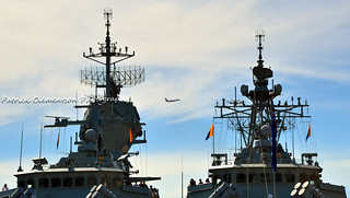QANTAS jet between the masts of Royal Australian Navy ships HMAS Perth (left) and HMAS Parramatta (right)