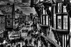 A view of Main Street, Chester from the bridge beside the Eastgate and Victorian Clock. (Bosca Fotograf) Tags: street old uk england blackandwhite white black art clock canon photography market main victorian chester busy dslr hdr shoppers eastgate whiteblack 600d