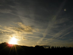 gridded sunrise (rospix+) Tags: uk trees light sky sun nature silhouette wales clouds sunrise countryside october hills contrails 2013 geoengineering rospix