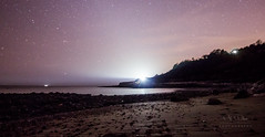 Look in to the Light (Miike Wiilson) Tags: longexposure sea sky lighthouse seascape beach night canon reflections stars landscape shadows shoreline nighttime 14mm 600d niton samyang