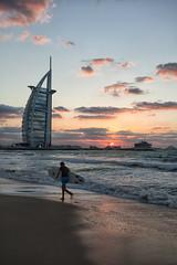 another beautiful day at jumeirah beach (azahar photography) Tags: blue sunset cloud motion beach sand dubai waves surfer uae wave emirates burjalarab surfboard jumeirah jumeirahbeach beautifulcolor aaharphotography