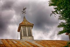 Weathervane (Steve Byrne's Pics) Tags: sky clouds rural rust outdoor lookup weathervane flickrfriday