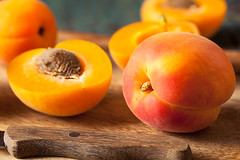 Raw Organic Yellow Apricots (brent.hofacker) Tags: red summer food orange plant nature yellow stone closeup fruit garden season juicy healthy stem raw natural bright sweet cut group peach seed tasty fresh delicious whole health slice meal vegetarian half apricot organic diet agriculture piece core apricots freshness crosssection ripe kernel freshfruit ingredient vitamin antioxidant slicedfruit apricotslices