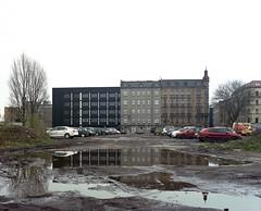 Katowice, Poland. (wojszyca) Tags: mamiya rz67 6x7 120 mediumformat 75mm shift kodak portra 160 gossen lunaprosbc epson 4990 city urban housing mud puddle reflection katowice overcast parking lot