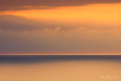 Atardecer dorado (Mimadeo) Tags: ocean light sunset red sea sky orange sunlight seascape color nature water beautiful beauty landscape gold dawn golden evening scenery colorful dusk background horizon scenic peaceful calm relaxation idyllic tranquil