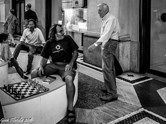 Chess player wanted (Gian Floridia) Tags: bw milano streetphotography tourists player bn wanted galleria chessboard piazzadelduomo bienne chessmates