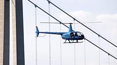 The helicopter by the bridge (Franz Airiman) Tags: bridge cruise chopper sweden helicopter cruiseship bro scandinavia suspensionbridge helo norrland hgakusten helikopter birka highcoastbridge hgakustenbron kryssning highcoast birkacruises kryssningsfartyg hngbro