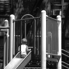 Lone at Playground 1 (ChicJean) Tags: park city playground bars play outdoor streetphotography boychild chicjean