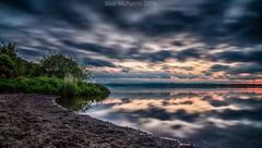 getting dark (blairmchattiephotography) Tags: blue sunset orange sun beach reflections scotland nikon long exposure fife hour loch leven d7000