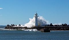 Swell (Kaptain Kobold) Tags: ocean blue sea sky lighthouse water weather coast harbour wave australia nsw swell wollongong kaptainkobold