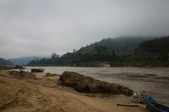 River Shoreline (JessicaAuen) Tags: beach water fog clouds river landscape boat rainforest asia riverside shoreline canoe shore tropical vehicle laos mekong slowboat riverscape