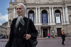. (www.piotrowskipawel.pl) Tags: street city woman opera cross faith religion streetphotography documentary streetportrait lviv ukraine oldwoman nationalopera lww documentaryphotography lvivoblast leopolis pawepiotrowski piotrowskipawelpl