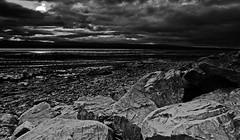 Rocky Bay (Marc McQuilling.) Tags: sea cloud sun beach water mono bay scotland highlands nikon rocks conversion north f11 harsh 18mm nigg d5100