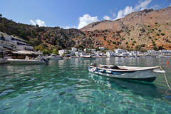 Loutro (Miguel Virkkunen Carvalho) Tags: travel houses light shadow sea summer mountains nature water composition digital canon boats photography seaside scenery europe mediterranean village angle outdoor turquoise south sigma august scene greece crete remote emerald whitewashed southerneurope photooftheday picoftheday loutro crystalclear sigma1020mm sfakia libyansea southcrete bestoftheday travelplanet eos1000d
